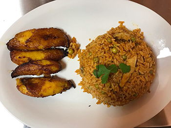 Arroz con Pollo / Mixed yellow rice, chicken, and vegetables